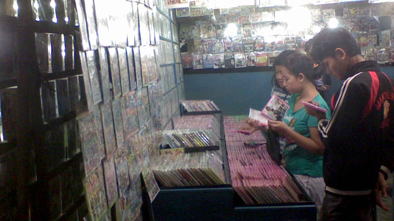Typical street vendors of pirated DVD and VCD in Indonesia.
